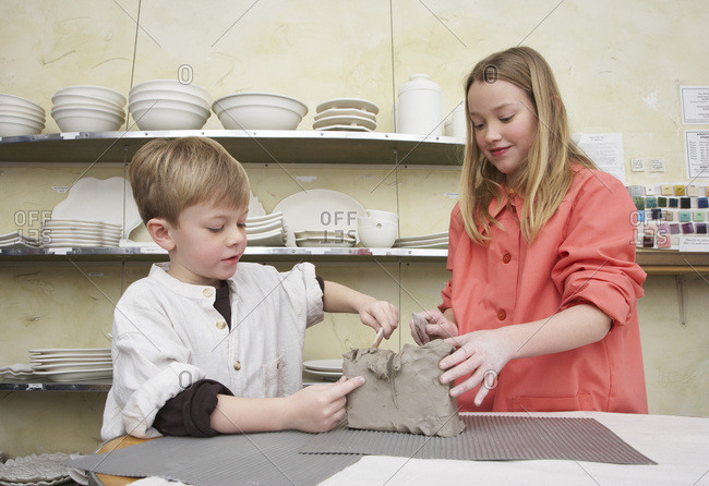 Boy and Girl in Pottery Studio