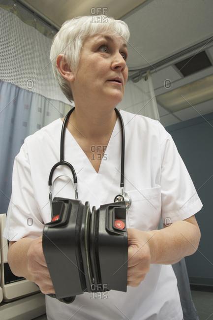 Doctor Using Defibrillator