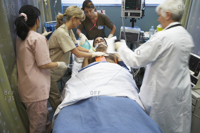 Doctor and Nurses Tending to Patient