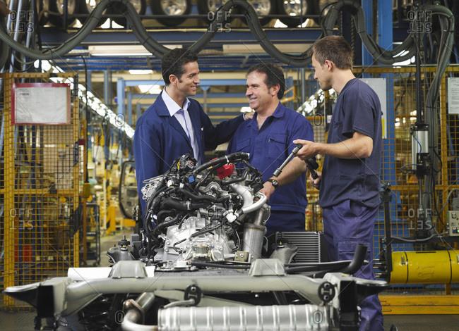 Men in Automotive Plant - Offset