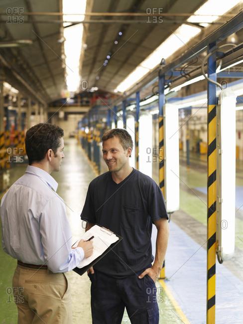 Men Talking in Automotive Plant