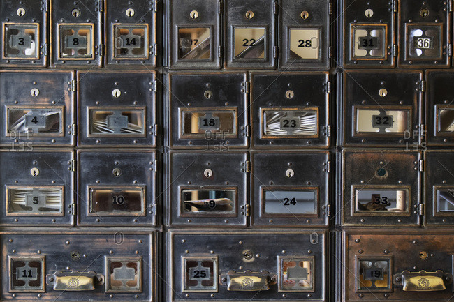 Wall of old post office boxes in Baskerville Historic Town in British Columbia, Canada
