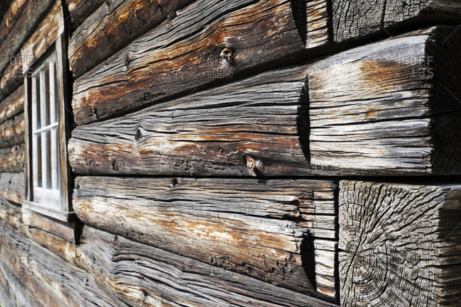 Close-up of weathered logs on traditional wooden building at Baskerville Historic Town in British Columbia, Canada