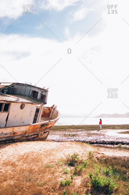 Old rusted ship aground the coast.