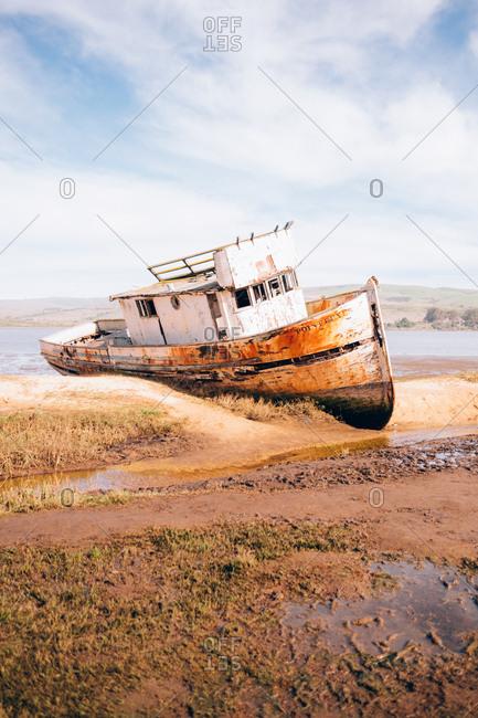 California, USA - February 14, 2016: Old rusted ship aground the coast.