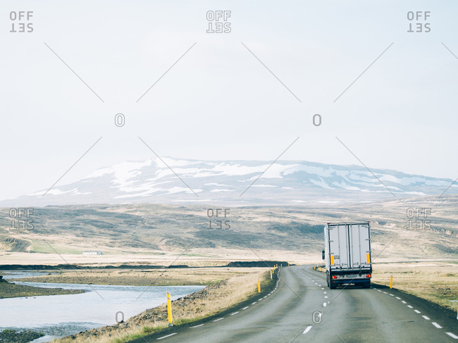Iceland - June 2, 2016: A rural road with the truck being driven on it.