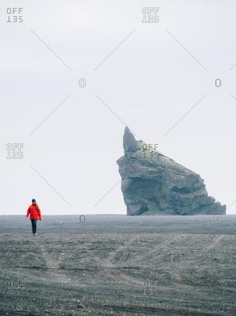 Woman is walking along the desert