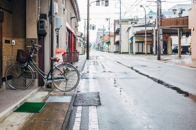 Japan - September 17, 2015: A lonely bicycle parked on a pavement.