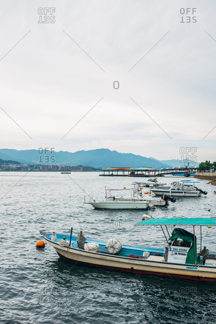 Japan - September 21, 2015: The variety of boats parked near shore.