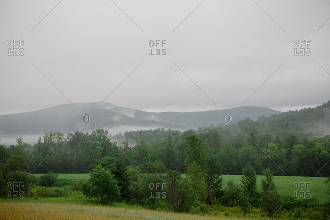Fields and distant mountains in the mist