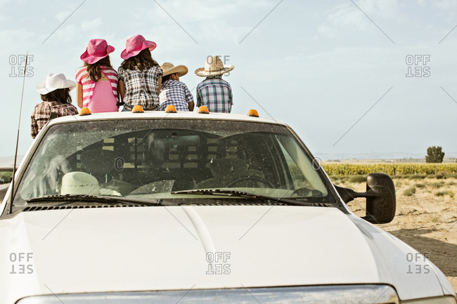 Hispanic family sitting in bed of truck