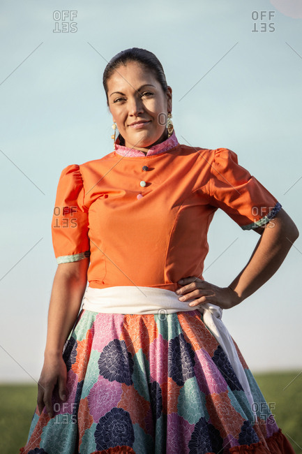Hispanic woman in traditional garb outdoors