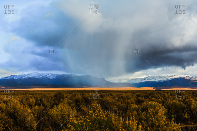 Storm clouds moving across rural prairie, Orovada, Nevada, United States