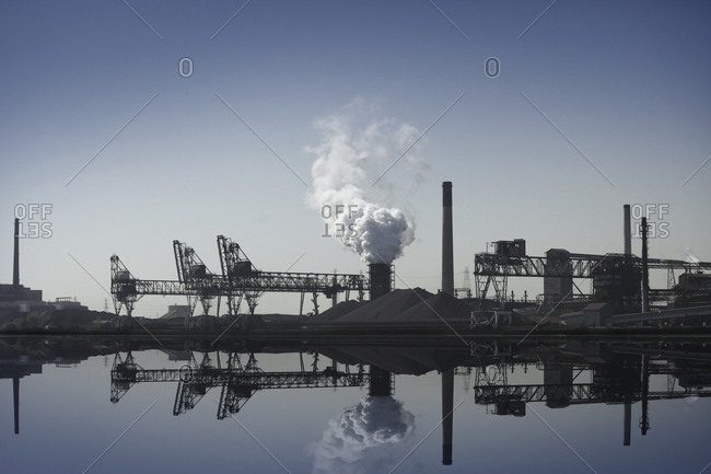 Nuclear power plant reflected in still lake, Detroit, Michigan, United States
