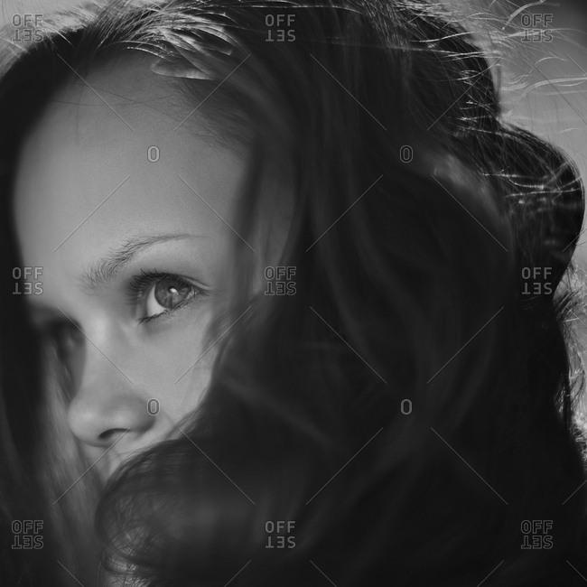 Caucasian girl peering over her hair