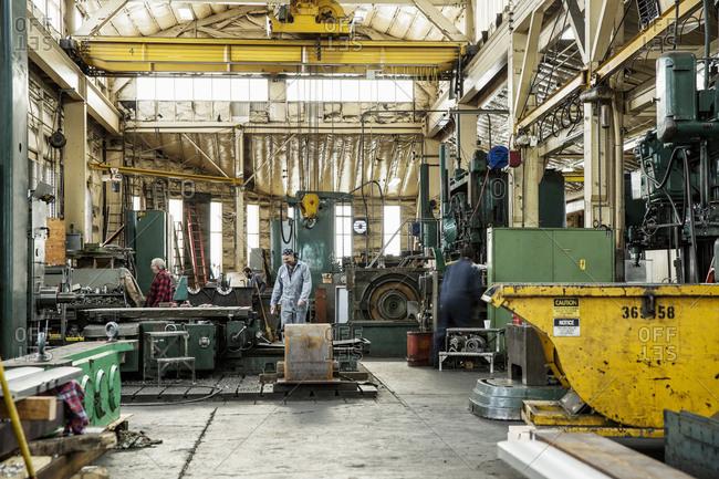 Men working in metal shop