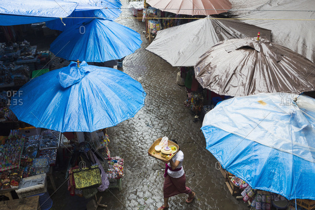 Rain falling over tarps and awnings of market stalls, Ubud, Bali, Indonesia