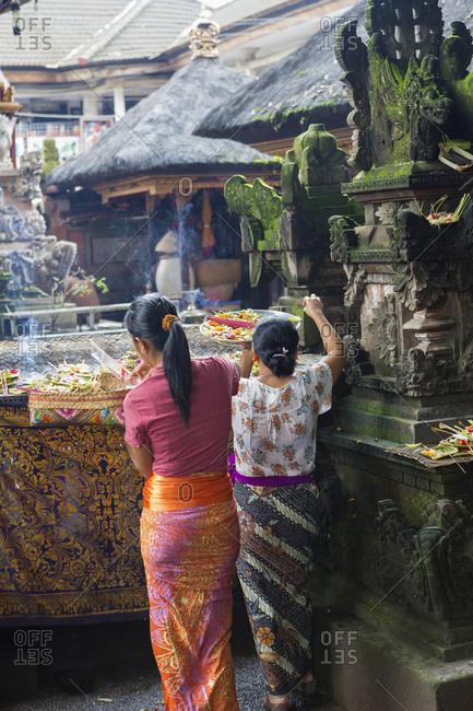 Women preparing Hindu celebration, Ubud, Bali, Indonesia