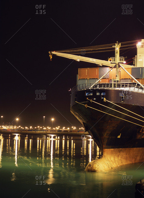 Illuminated crane and container ship at night, Port of Los Angeles, California, United States