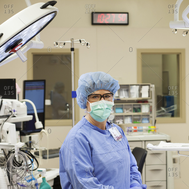 Caucasian surgeon sitting in operating room