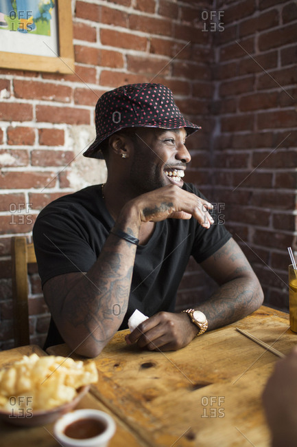 African American man laughing in restaurant