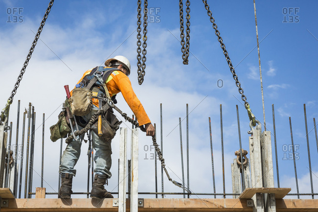 Caucasian worker holding chain at construction site