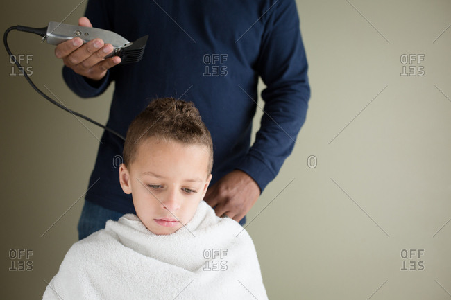 Boy Getting A Haircut At Home About To Have Clippers Used To Shave