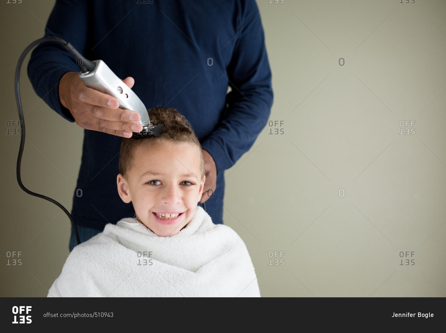 Smiling boy getting his head shaved with clippers during a home smiling boy getting his head shaved with clippers during a home haircut winobraniefo Image collections