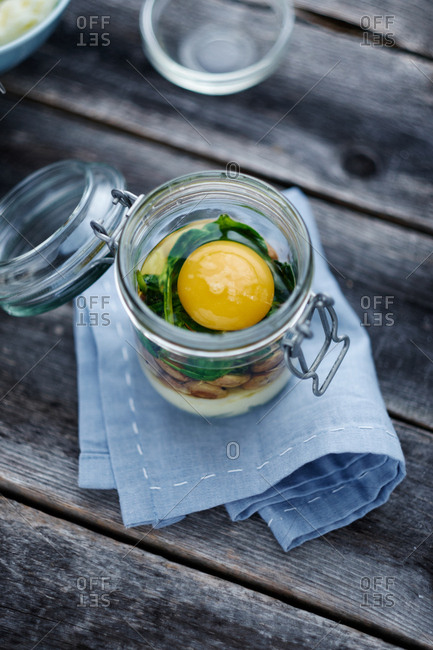 Egg and ingredients in jar