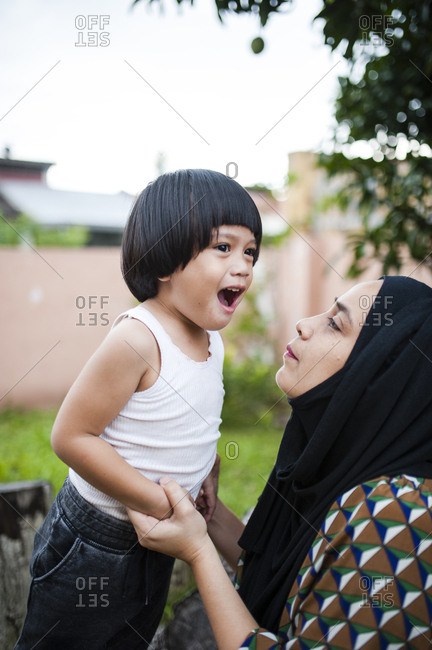 Loving mom with boy in backyard