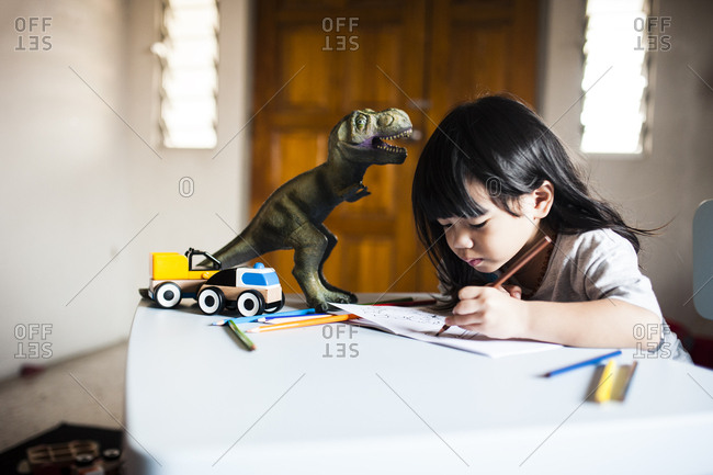 Malaysian boy drawing by toys