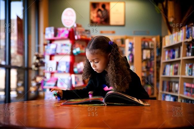 Girl reading inside a library