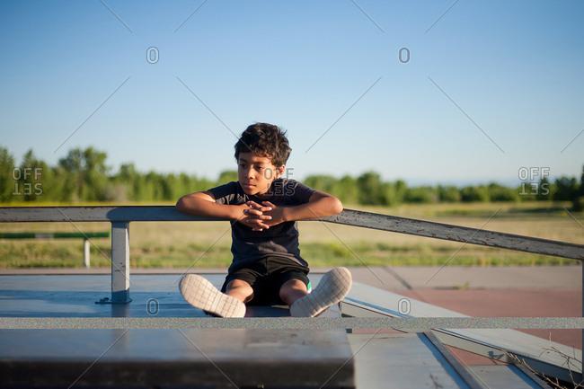 Boy on a rural platform staring off