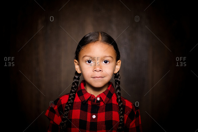 Girl in pigtails and plaid shirt