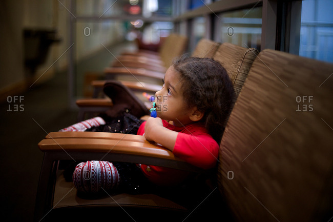 Girl in waiting area staring off