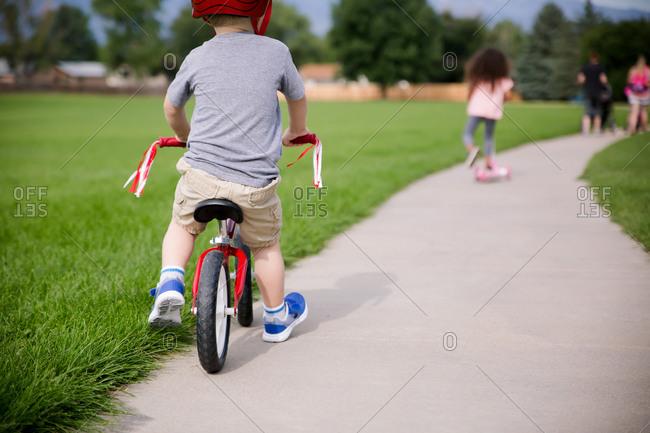 Kids riding bikes on park path