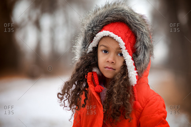 Girl in a hooded coat in winter