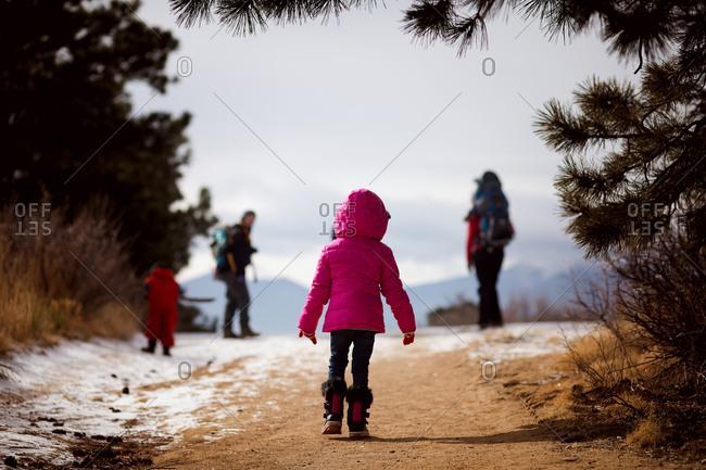 Girl walking on a rural path in winter