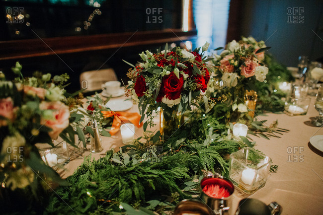Roses and boughs on wedding table