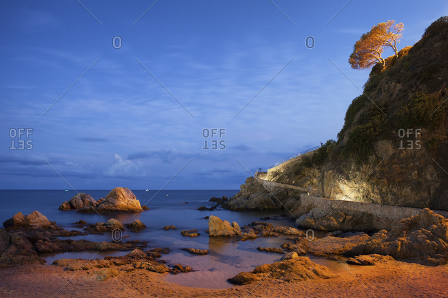 Spain- Catalonia- Lloret de Mar- Costa Brava- sea shore with cliff at twilight