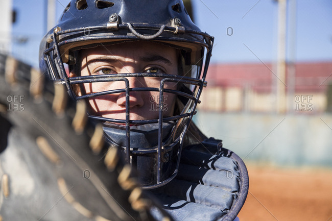 Female catcher ready to catch the ball during a baseball game