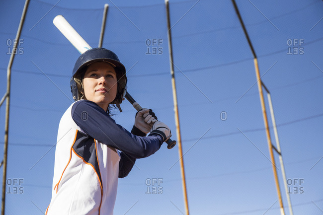 Female batter ready to hit the ball during a baseball game