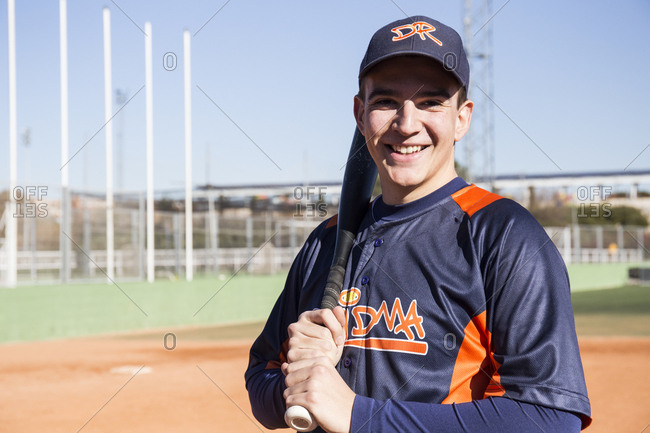 Portrait of smiling baseball player with a baseball bat
