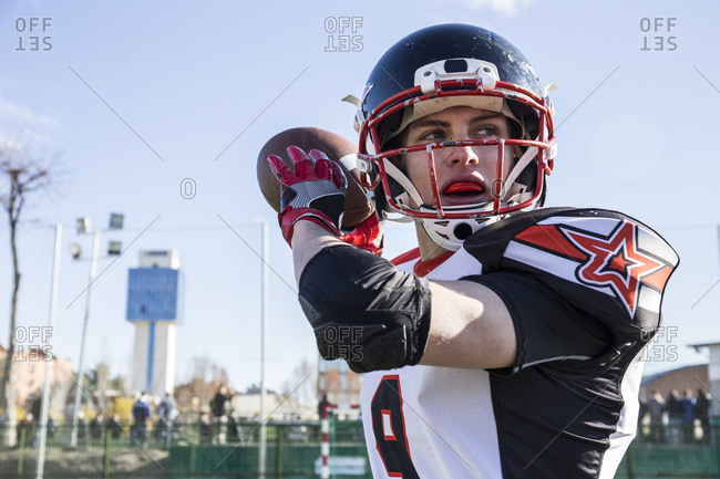 American football player throwing the ball during a match