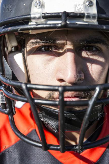 Close-up portrait of American football player with helmet
