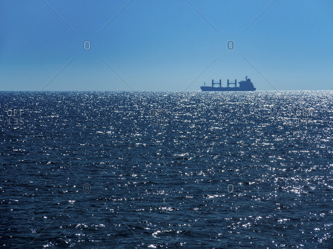 Italy- Sicily- cargo ship on the ocean