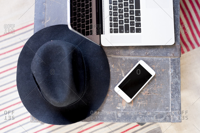 Hat- laptop and cell phone