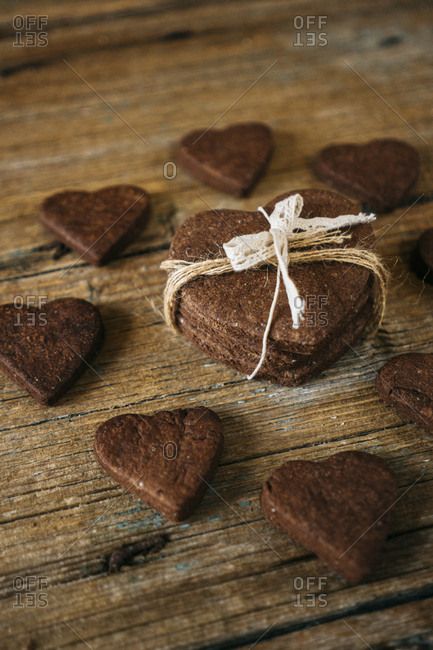 Heart-shaped chocolate shortbreads  on wood