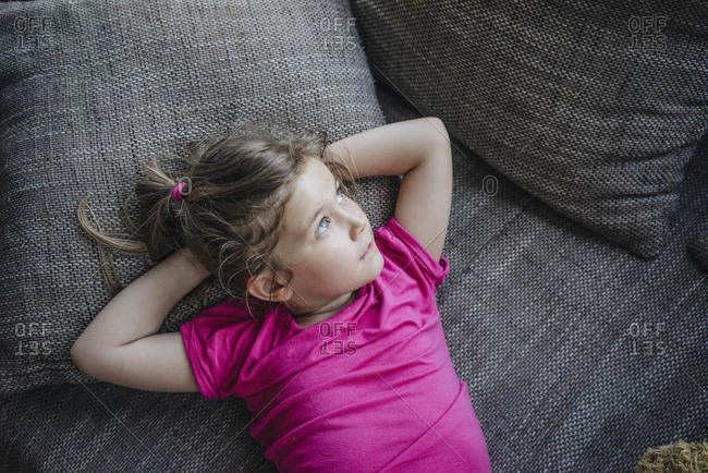 Portrait of girl lying on couch