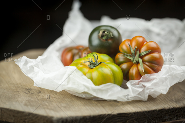 Various Oxheart Tomatoes on paper